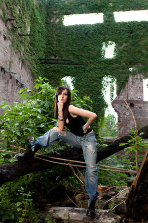 Lovely brunette in a deserted building with a ready to conquer attitude Stock Photo - 19339791