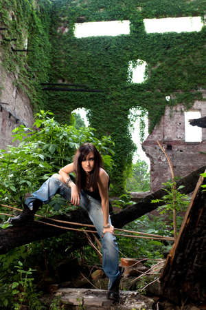 Portrait of a beautiful brunette, posing in a abandoned building  photo