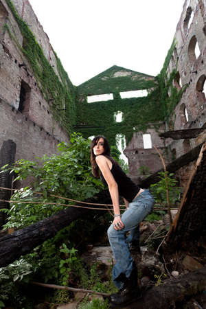 Lovely brunette with a rockier attitude posing in a deserted building  photo