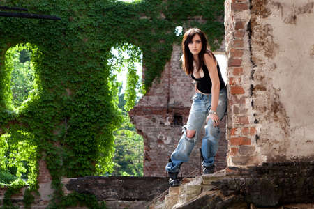 Stunning brunette with a daring attitude, wearing torn jeans Stock Photo - 20680852