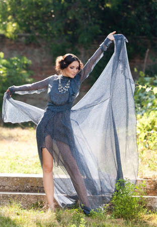 transparent dress:  Gorgeous sexy woman, in long transparent dress, dancing  in a carefree attitude