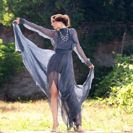 transparent dress:  Elegant woman, in long transparent dress, posing in a graceful attitude  Stock Photo