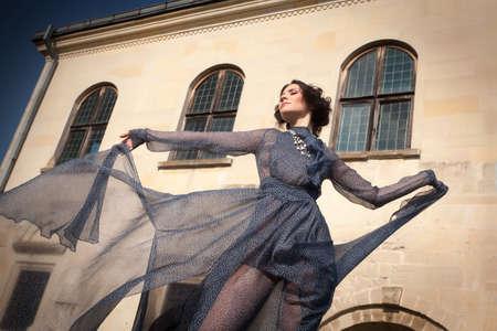 transparent dress: Elegant woman, in long transparent dress, posing in a graceful attitude