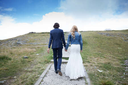 trash the dress: Married couple taking a walk on a stepped path. It looks like they are climbing stairs to the sky.