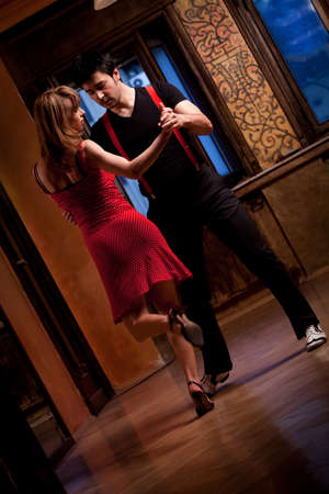 A man and a woman in the most romantic dance: tango.