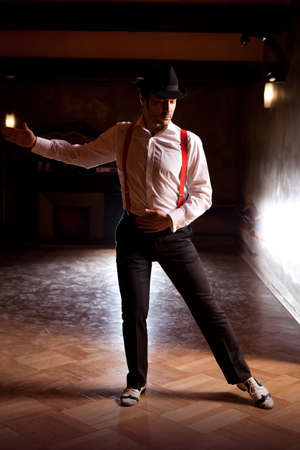 tangoing: Powerful pose of a tango male dancer.