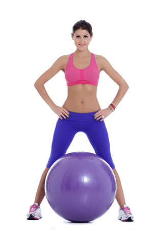 swiss ball: Fit woman ready for some exercise with the swiss ball. Stock Photo