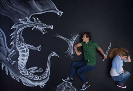 Young man protecting his pregnant woman against a fearless drawing dragon.