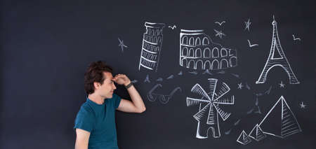ilustrations: Young man thinking about travel the world. Large copy space on left. Stock Photo