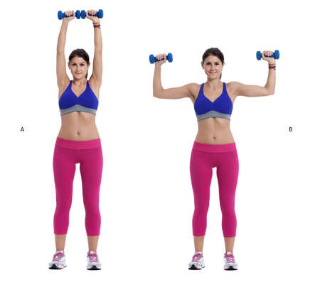 facing away: Step by step instructions:  Stand with your feet hip-width apart, holding a pair of dumbbells, palms facing away from you. Curl the weights to shoulder height. (B) then rotate your hands so that your palms face forward and press the dumbbells toward the c Stock Photo