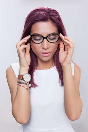 pleasure: Young woman having a moment of pleasure wearing eyeglasses.