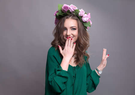 circlet: Young lovely woman smiling and having good time wearing a nice flower circlet.