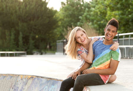 Happy and joyful people hanging around in a skate park.