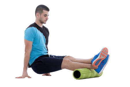 Foam roller exercise explanation and execution with a trainer.