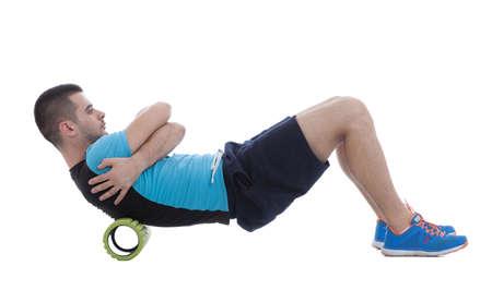 rodillo de espuma ejercicio explicación y ejecución con un entrenador. Foto de archivo