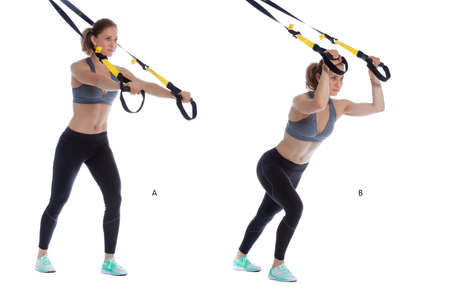 Athletic woman performing a functional exercise with suspension cable. Stock Photo