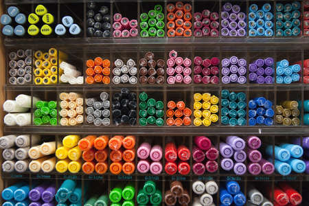 Multicolored drawing materials stored in a store.