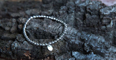 Beautiful bracelet made of white gold on a nice textured background.