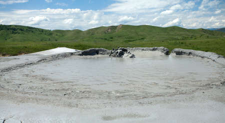 Image of a mud volcano erupting gas.
