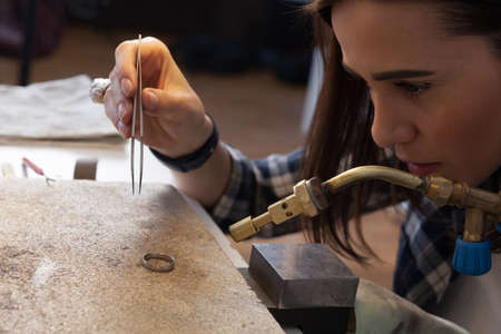 Jeweler at work, crafting in a jewelery workshop.