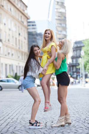 Lovely young women having fun in the city streets.