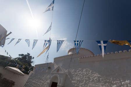 Lovely view in a Greek island street atmosphere 写真素材