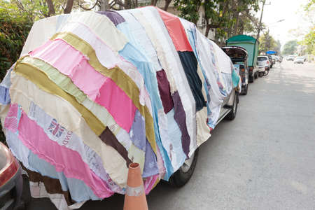 CHIANG MAI, THAILAND - FEBRUARY 21, 2018: An unusual car canvas that is patched with many small pieces of different fabric.