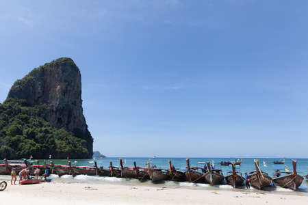 RAYLAY, THAILAND - FEBRUARY 27, 2018: View of many long tail boats parked near to the Raylay beach. They are used to transport tourists every 30 minuntes from Krabi beach.