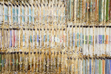 Many bracelets and accessories in a souvenir shop. Stock Photo