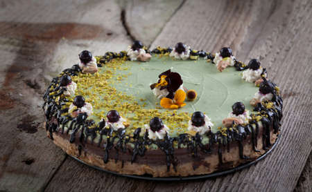 Delicious raw vegan cake with lovely decorations on it.