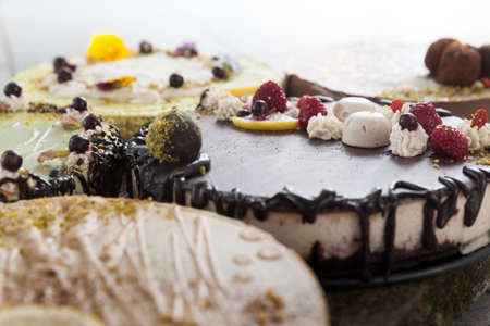 Delicious raw vegan cakes with lovely decorations on it.