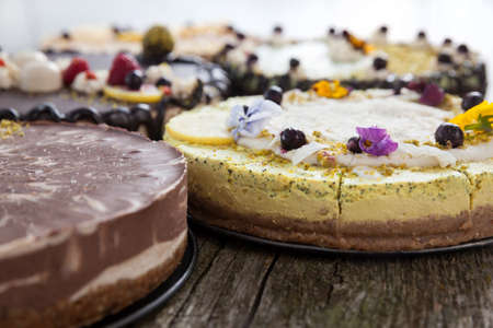 Delicious raw vegan cakes with lovely decorations on it. Stock Photo