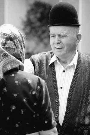 Portrait of a romanian traditional very old couple on country side. Focus on the mans face expression. See more images with them. Stock Photo