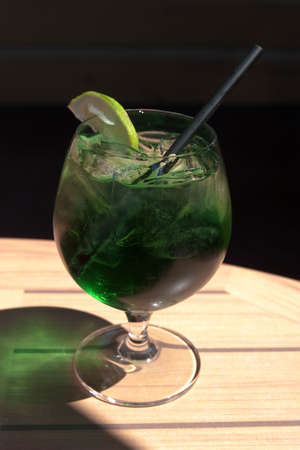 Green mint gin cocktail with lime and straw Stock Photo