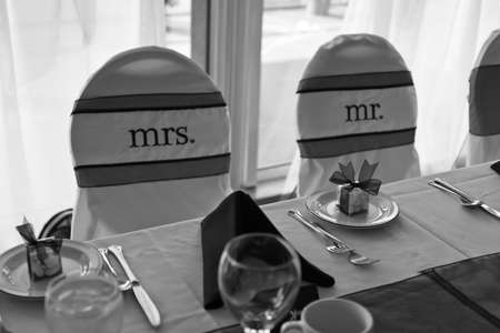 Wedding chairs with Mr. and Mrs. labels for bride and groom