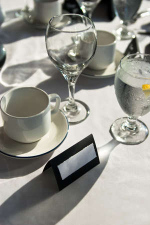 Black and white place setting at wedding with blank name card Stock Photo