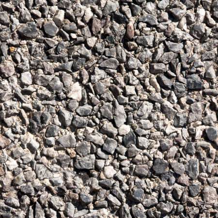 wall textures: Seamless tile background of small stones on sidewalk or wall