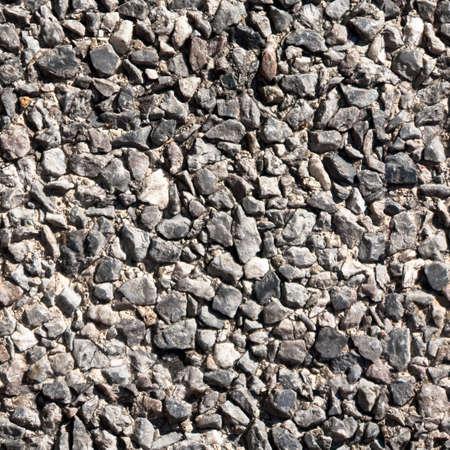 Naadloze: Tile van naadloze achtergrond van kleine stenen op de stoep of muur