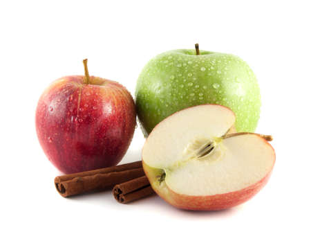 Isolated wet green and red apple with sliced half and cinnamon pods on a white background. Fresh diet fruit. Healthy fruit with vitamins. photo