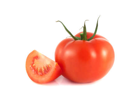 Isolated red tomato with slice on a white background (fresh). photo