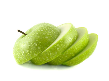 Isolated green apple slices with water drops (white background). Fresh diet fruit. Healthy fruit with vitamins.