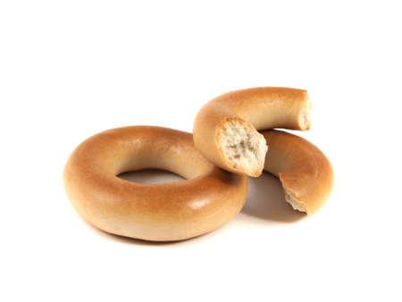 boublik: Bagels isolated on white background (two). Broken bagel.