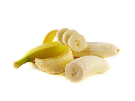 Opened banana with slices (half) isolated on white background (ripe). Healthy fresh fruit with vitamins. photo