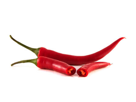 Sliced red chili hot pepper on white background. Isolated healthy vegetable. photo