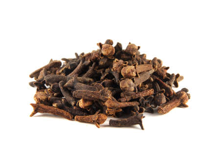 Heap dried cloves isolated on white background