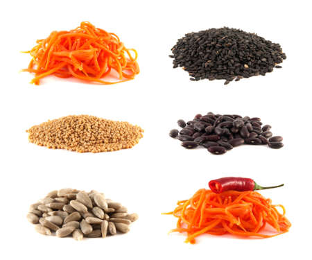Carrot, sesame, mustard, sunflower seeds, beans collection isolated on white background photo