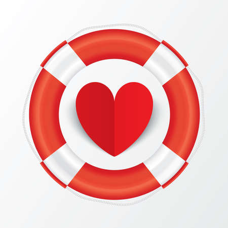 Red paper heart in lifebuoy photo