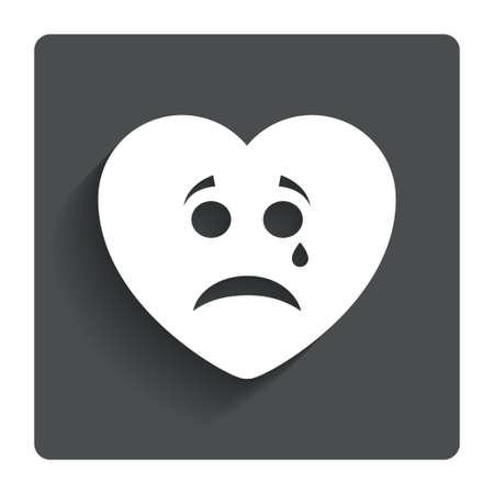 Sad heart face with tear sign icon.  photo