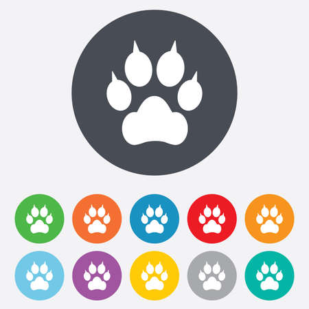 clutches: Dog paw with clutches sign icon. Pets symbol. Round colourful 11 buttons. Stock Photo