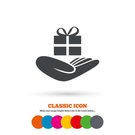 present box: Give a gift sign icon. Hand holds present box with bow. Classic flat icon. Colored circles. Vector